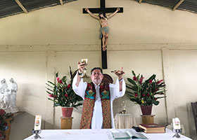 Father Alfredo Ferro celebrates Mass in Colombia